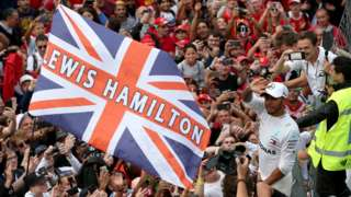 Lewis Hamilton celebrates winning the Italian Grand Prix at Monza