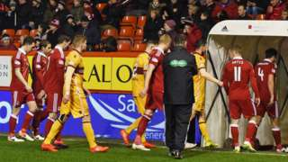 Aberdeen and Motherwell players trudge off after six minutes