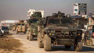 Turkish military convoy passes through the Syrian town of Dana on 2 February 2020