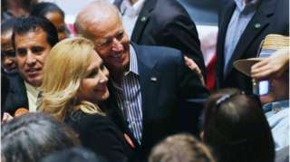 Joe Biden poses with a female supporter on the campaign trail in 2012