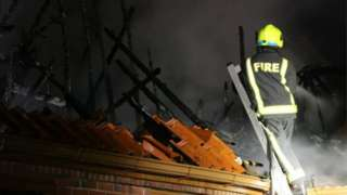 Firefighter tackles house fire