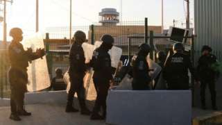 Police officers stand outside a penitentiary during a fight among inmates in Villahermosa, in Tabasco state, Mexico June 22, 2021
