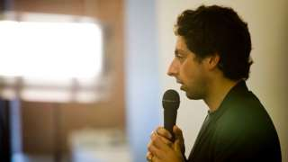 Sergey Brin with microphone.