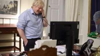 Prime Minister Boris Johnson during a phone call with US Presient Joe Biden