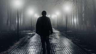 Man walking alone at night, file pic