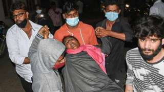 A woman being rushed to hospital.