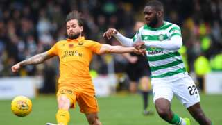 Livingston's Keaghan Jacobs (left) holds off Celtic's Odsonne Edouard