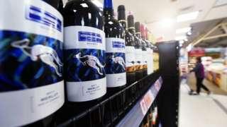 Bottles of Australian wine in supermarket aisle.