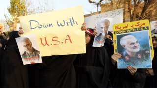 Iranian women hold up anti-US posters at a protest outside the British embassy in Tehran, Iran (12 January 2020)