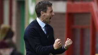 Interim Dundee boss Neil McCann celebrates his side's third goal