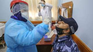 Hospital staff tested for coronavirus in Rafah in the southern Gaza Strip on August 31, 2020