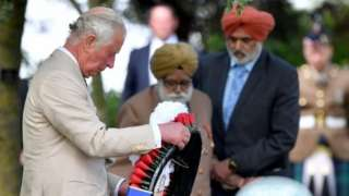 """Britain""""s Prince Charles lays a wreath at the VJ Day National Remembrance event,"""