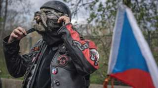 Czech members of motorcycle club 'Night Wolves' lay a wreath on 5 May
