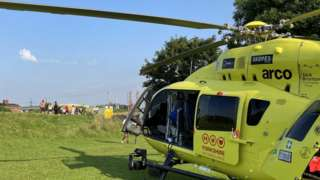 Helicopter and ambulance at scene