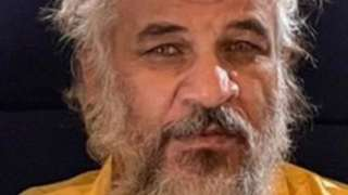 Handout photo from Iraq's Security Media Cell showing Sami Jasim al-Jaburi after his capture (11 October 2021)
