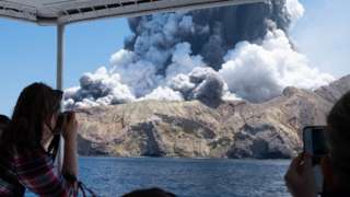 Tourist take pictures of the White Island eruption