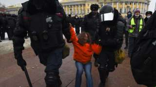 Riot police detain a protester during a rally in support of jailed opposition leader Alexei Navalny in Saint Petersburg on 23 January 2021.