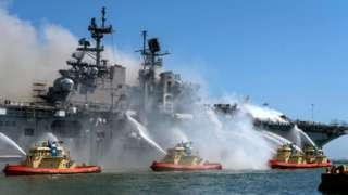 File photo showing firefighters near ship