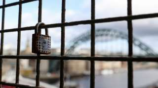 A lock on the High Level Bridge with the Tyne Bridge in the background