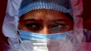 A nurse wearing PPE