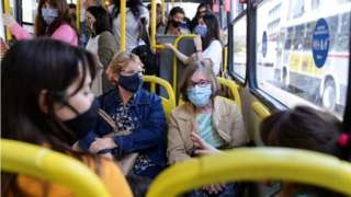 People wearing protective face masks ride a bus, as the spread of the coronavirus disease (COVID-19) continues in Montevideo, Uruguay November 18, 2020.