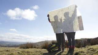 Walkers with a map