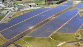 Former runway at RAF Coltishall surrounded by solar energy panels