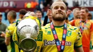 Norwich City striker Teemu Pukki with the Championship trophy