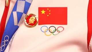 A Chinese cyclist wears a Mao badge during a medal ceremony at the Olympics