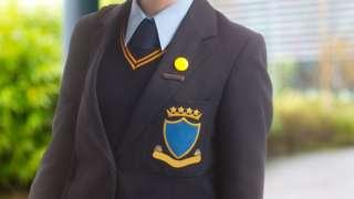 Schoolgirl dressed in school blazer