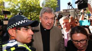 Image shows Cardinal George Pell arriving at court earlier this month