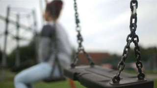 Woman on park swing