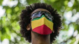 A member of the Ethiopian community wears an Ethiopian flag face mask at the US State Department to protest the ongoing murder and ethnic cleansing of members of the Amhara ethnicity in multiple regions in Ethiopia at the U.S. State Department on May 17, 2021 in Washington, DC.
