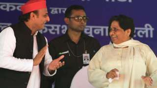 Bahujan Samaj Party (BSP) president Mayawati (L) and Samajwadi Party (SP) president Akhilesh Yadav (R) wave at the SP-BSP-RLD alliances first joint rally in Deoband in Uttar Pradesh state on April 7, 2019.