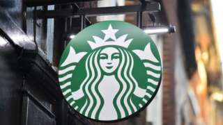 A logo outside a branch of Starbucks
