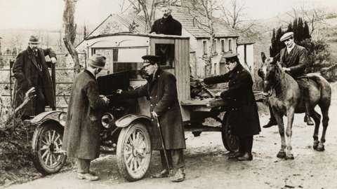 A truck returning from Northern Ireland is stopped at the border by Irish Free State customs officers (1925)