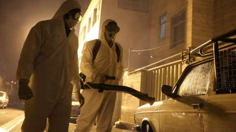 Iranian firefighters disinfect streets in Tehran to halt the wild spread of coronavirus in March 2020