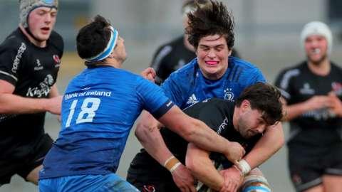 Leinster duo Tom Clarkson and Alex Soroka tackle Ulster fly-half Bill Johnston