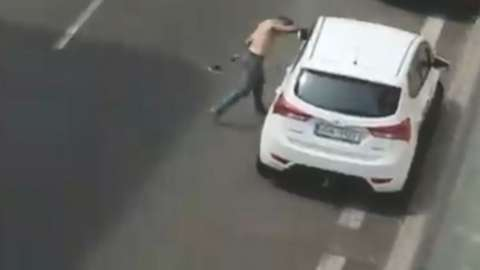 Police published a video showing the man attacking a car window and fighting with another man before they arrived