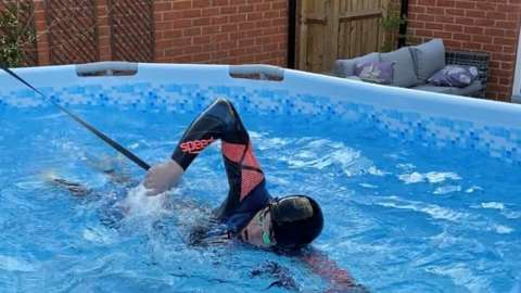Matt Richards training in an over ground pool at home