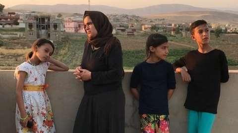 Bahar Dawood and her three children