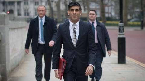 Rishi Sunak walks from the Treasury to No 11 Downing Street