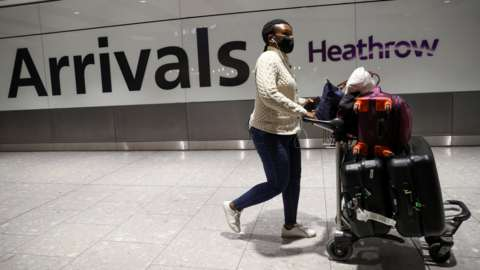File photo showing a traveller arriving at Heathrow Airport