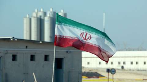 Image shows an Iranian flag in Iran's Bushehr nuclear power plant