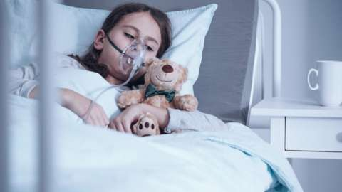 Child with cystic fibrosis in a hospital bed