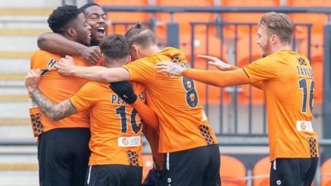Barnet celebrate Wesley Fonguck's goal