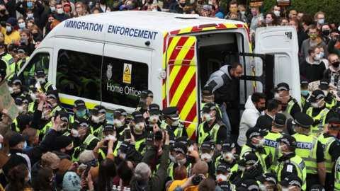 -Two men are released from the back of an Immigration Enforcement van accompanied by lawyer Aamer Anwar and Mohammad Asif, director of the Afghan Human Rights Foundation, in Kenmure Street, Glasgow