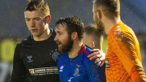 Inverness Caledonian Thistle striker James Keatings (centre) leaves the field