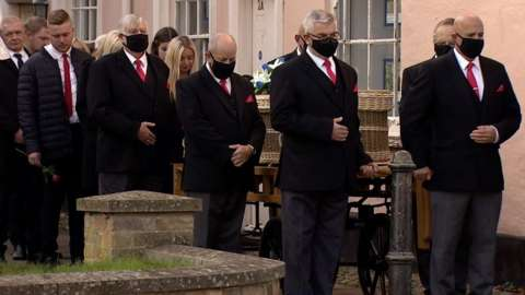 Mourners at the funeral of Simon Dobbin