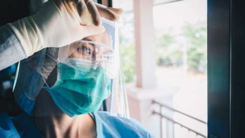 file picture of person using PPE